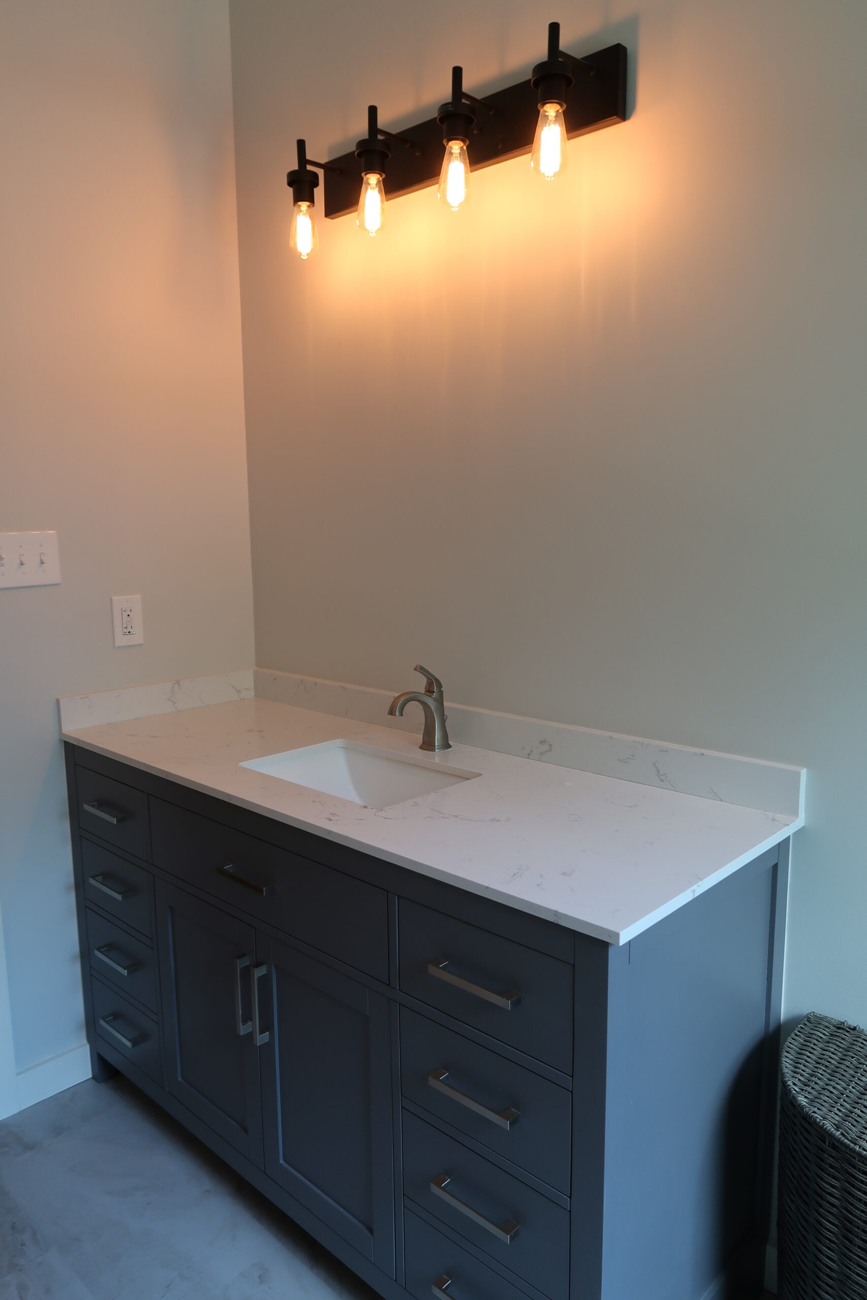 Stainless Fixtures and Hardware With Black Metal Lighting